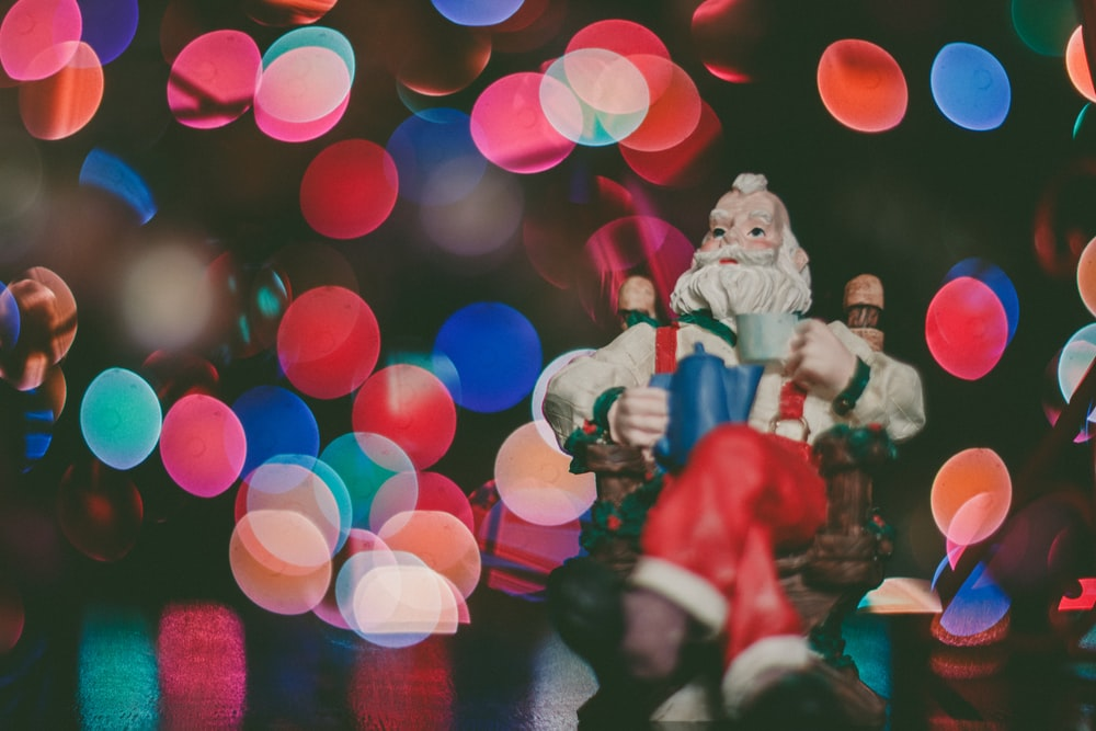 macro photography of Santa Claus figurine on top of surface