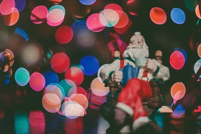macro photography of santa claus figurine on top of surface xma zoom background