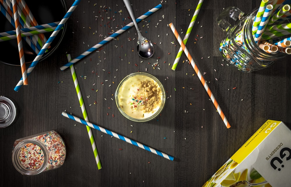 Party straws and candy desserts.