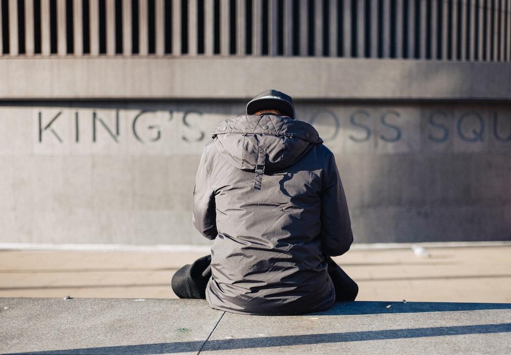 man in gray jacket sitting