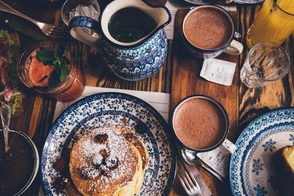 blue and white ceramic dinnerware set on table