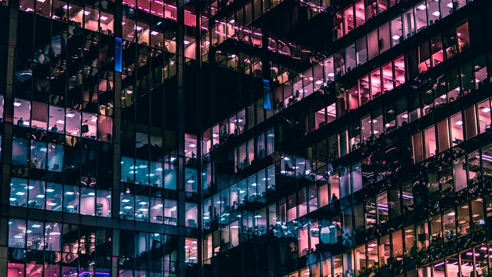 architectural photography of building with people in it during nighttime