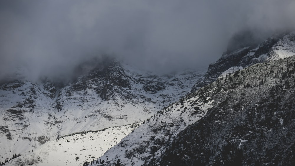 aerial photography of fog covering mountain top