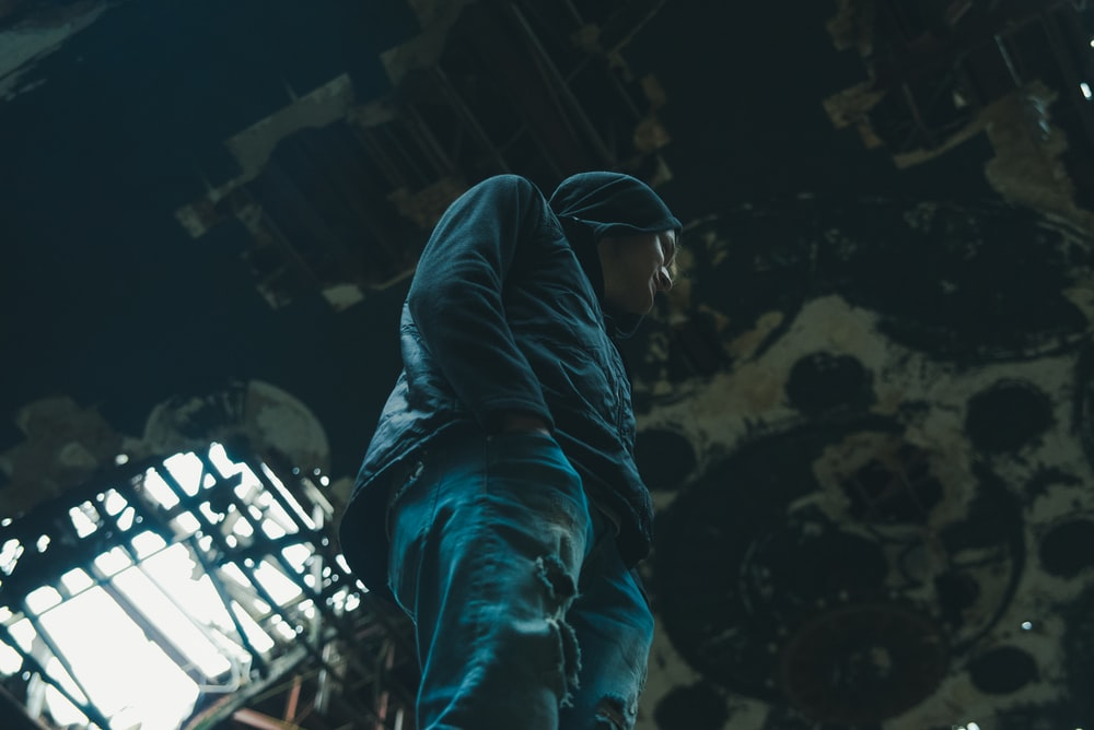 man in hooded jacket standing