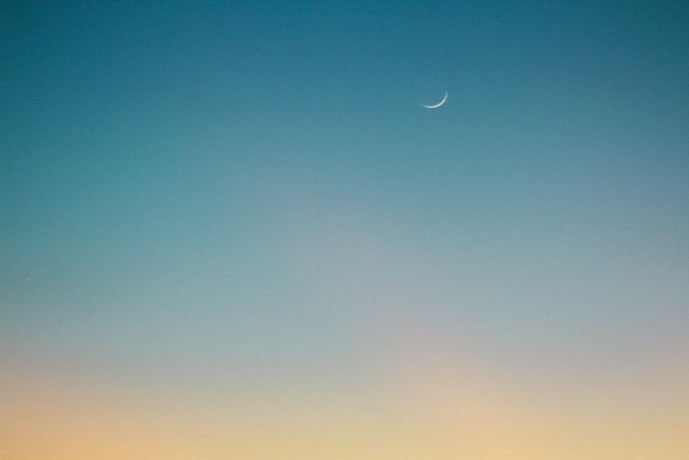 crescent moon on blue sky