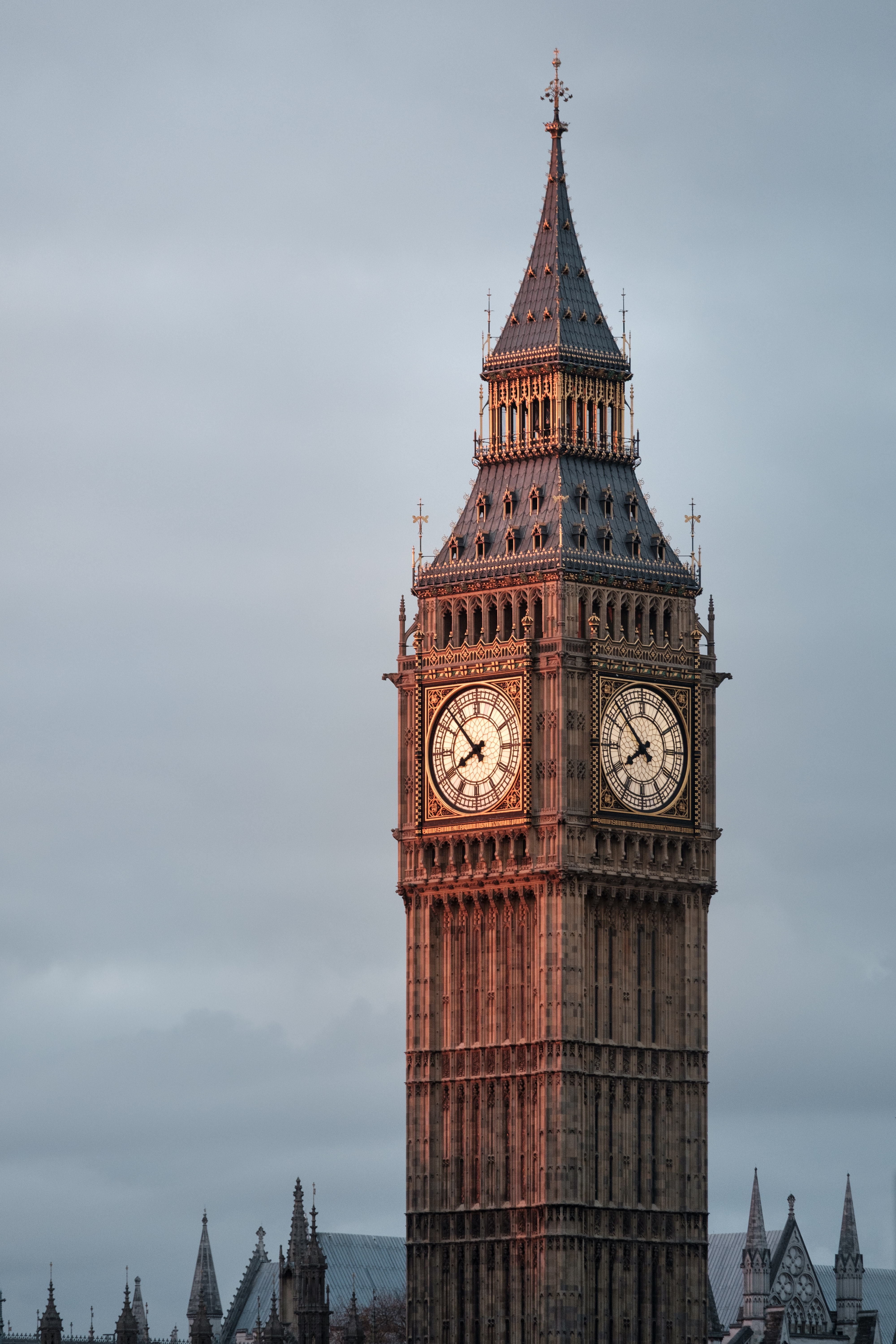 Big Ben clock tower in the early light of morning with  the sun shining on the clock face