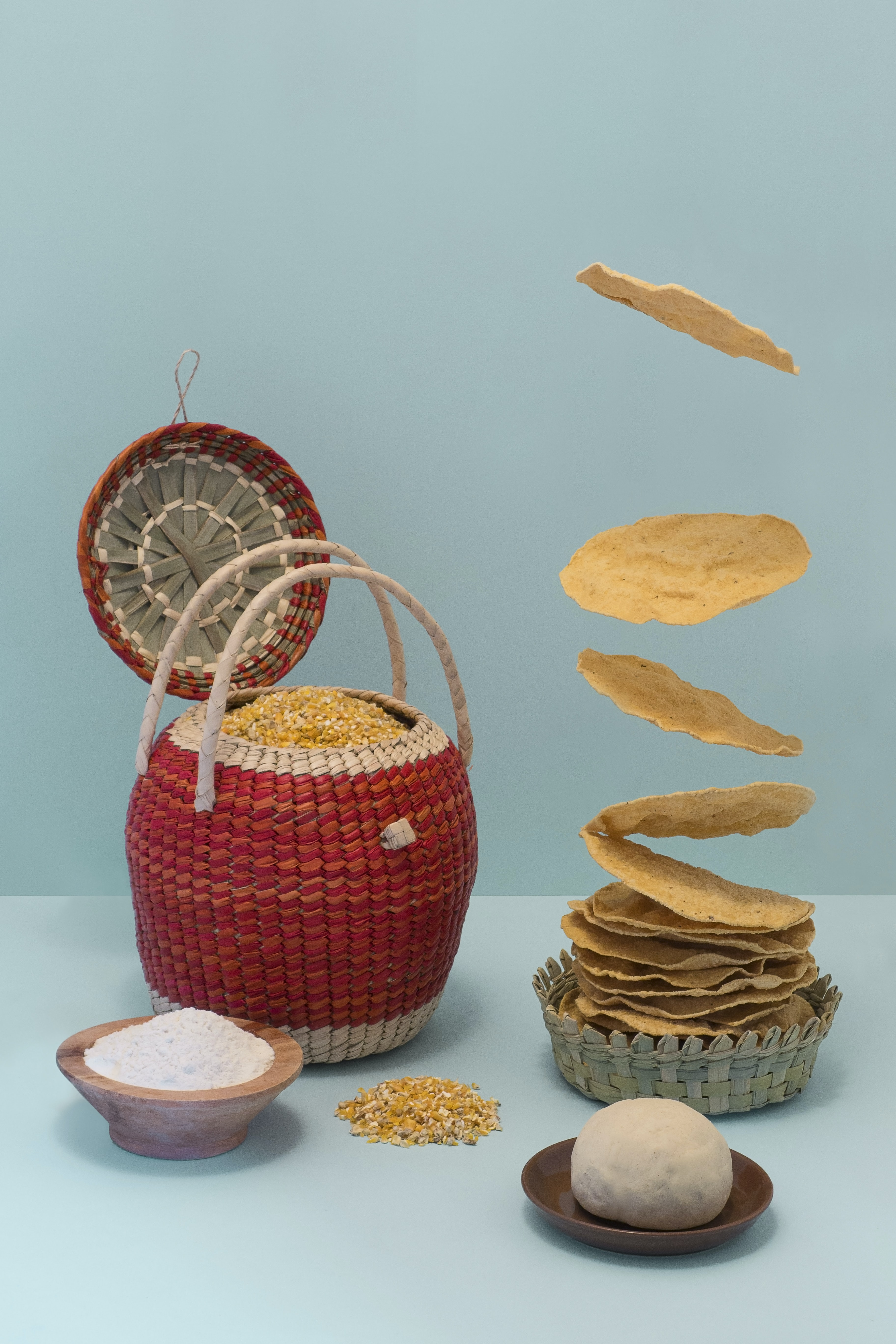 Abstract shot of Mexican tortillas falling into a pile surrounded by fresh ingredients