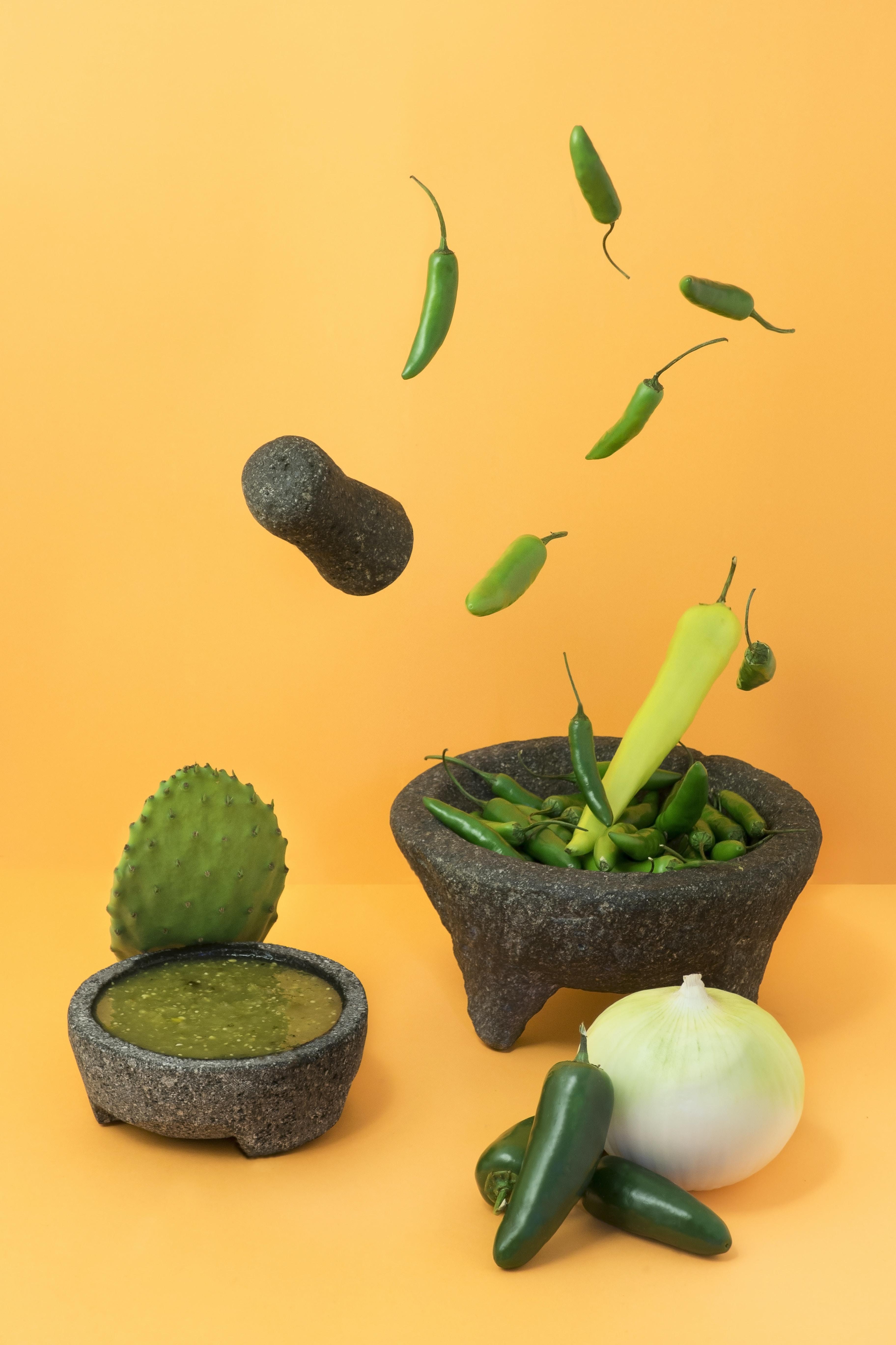 Various vegetables on an orangish yellow surface.