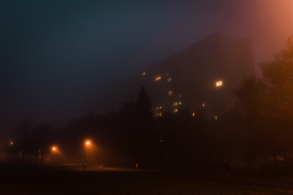 A large building on a foggy night.