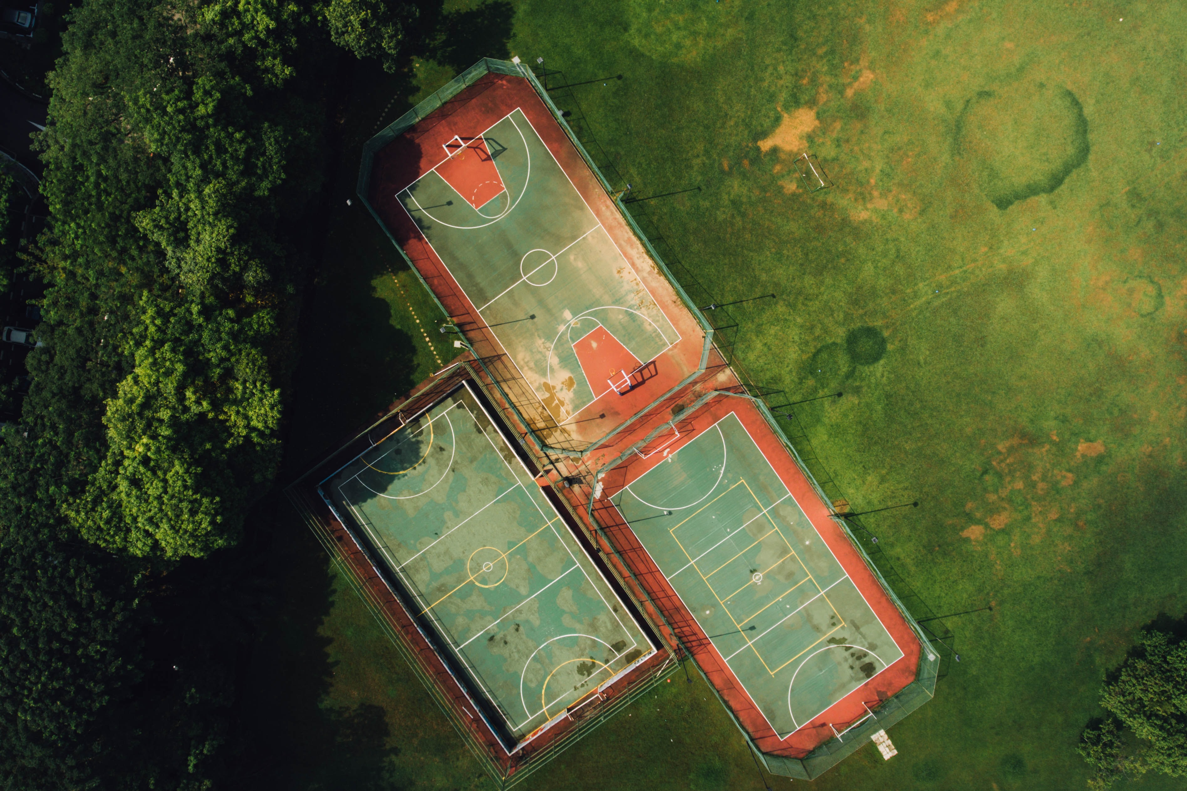 A drone shot of three sports fields in a park