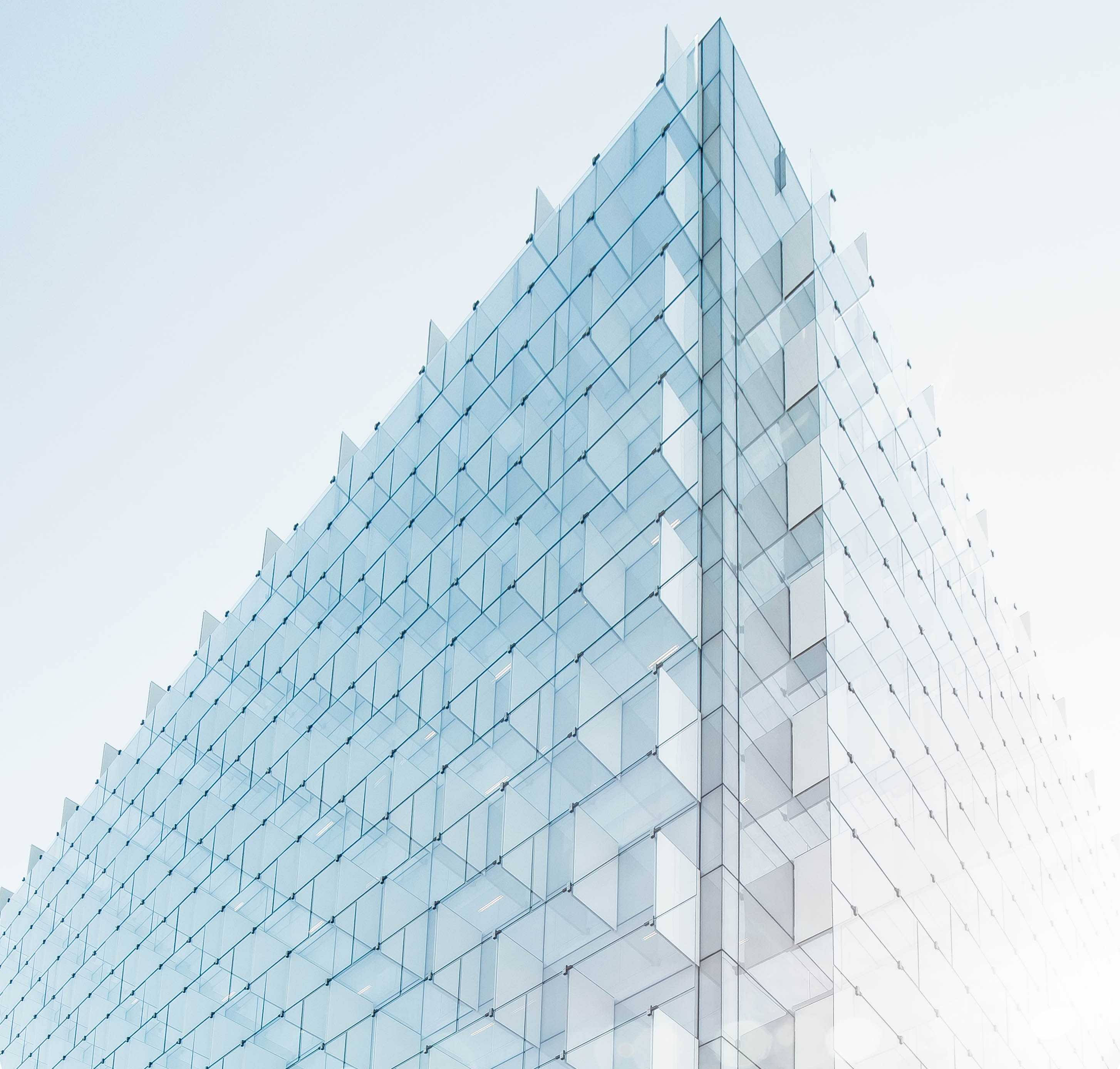 The edge of a building facade with glass plates on it in Madrid