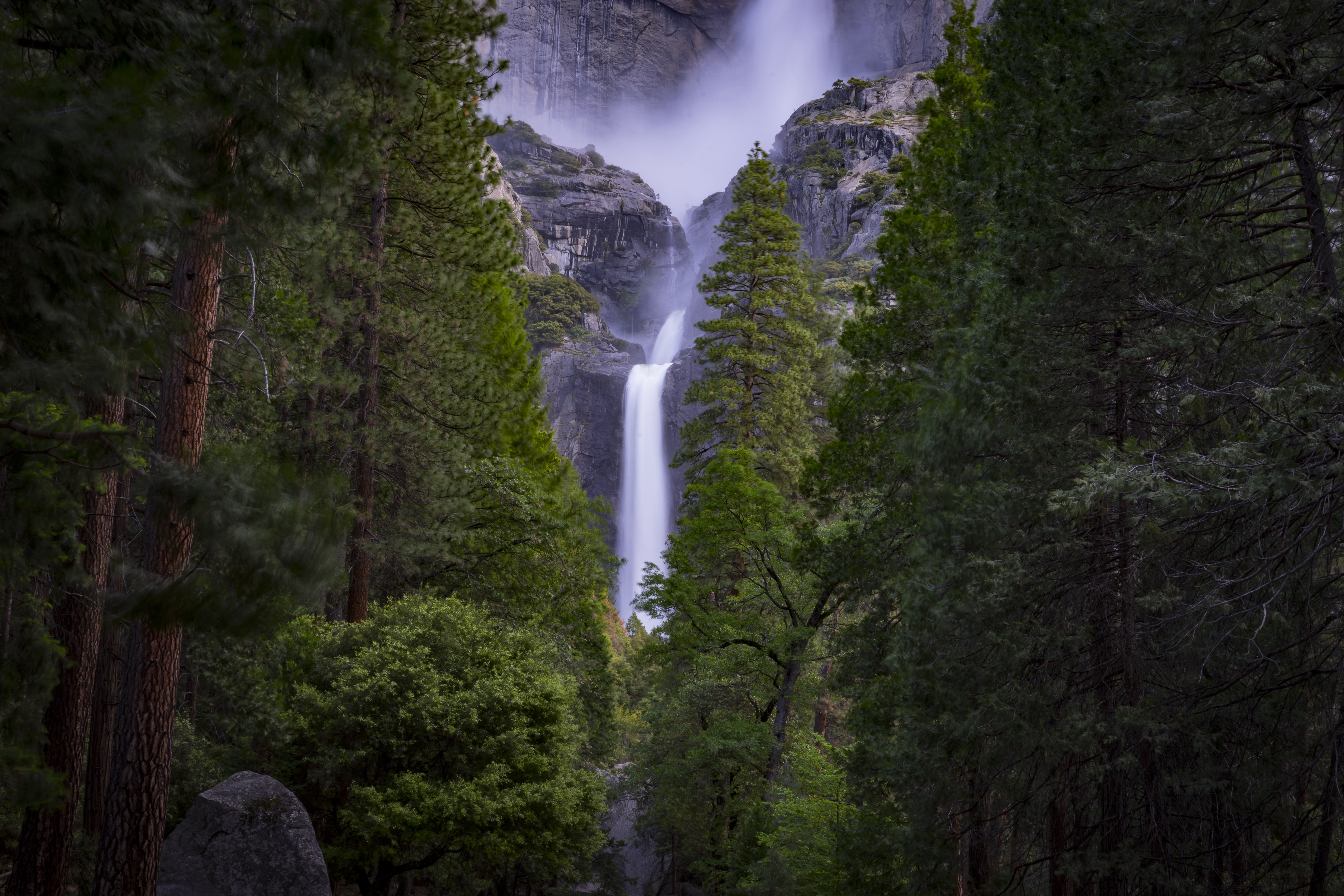 A frothy waterfall pouring down a rock formation in Yosemite Valley