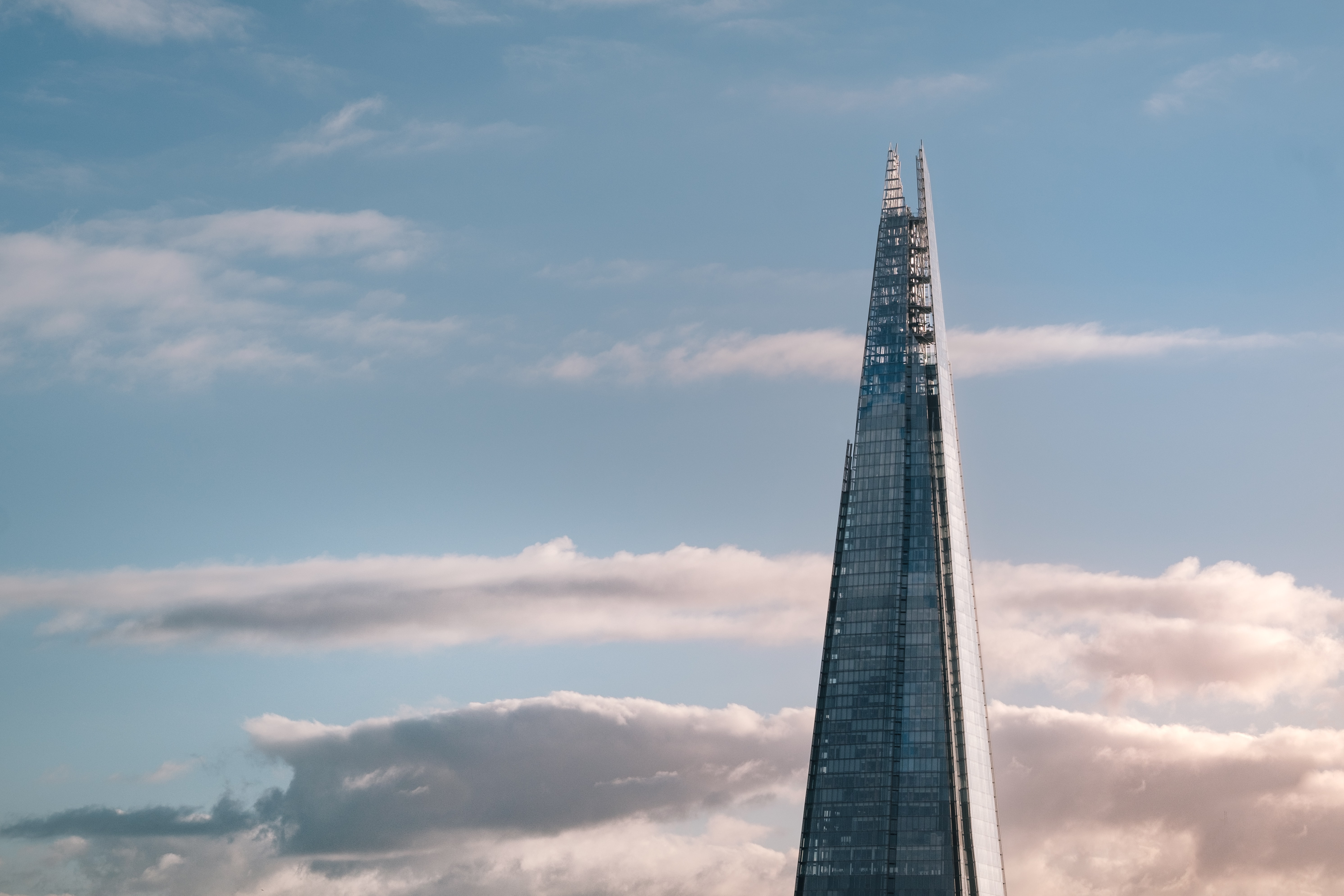 high-rise tower with white clouds in background