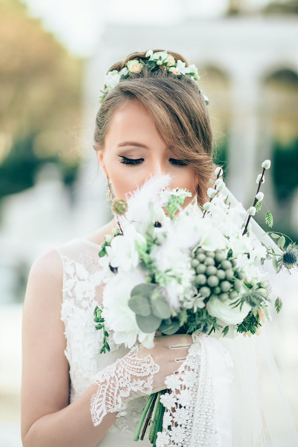 bride smelling the flowers