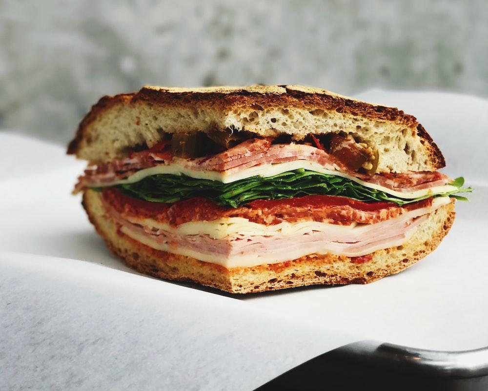 ham sandwich on white surface