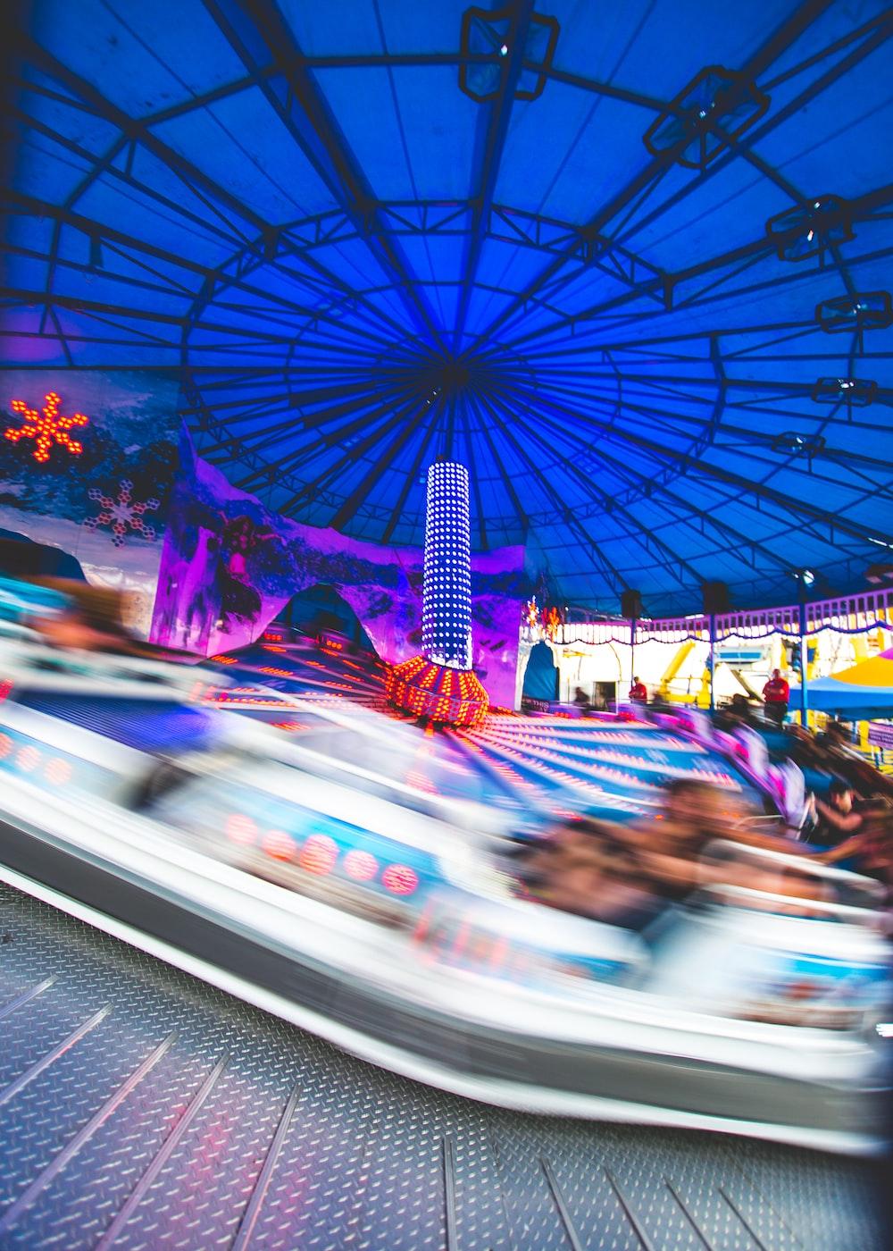 people riding carousel during daytime