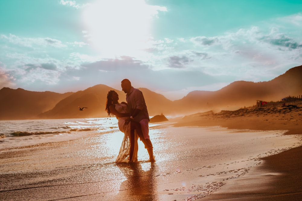 couple walking in seashore