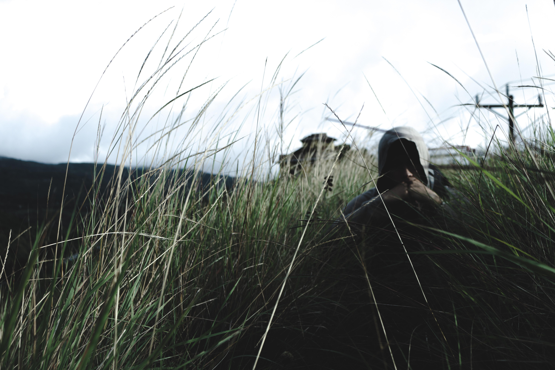 man in hoodie near grass