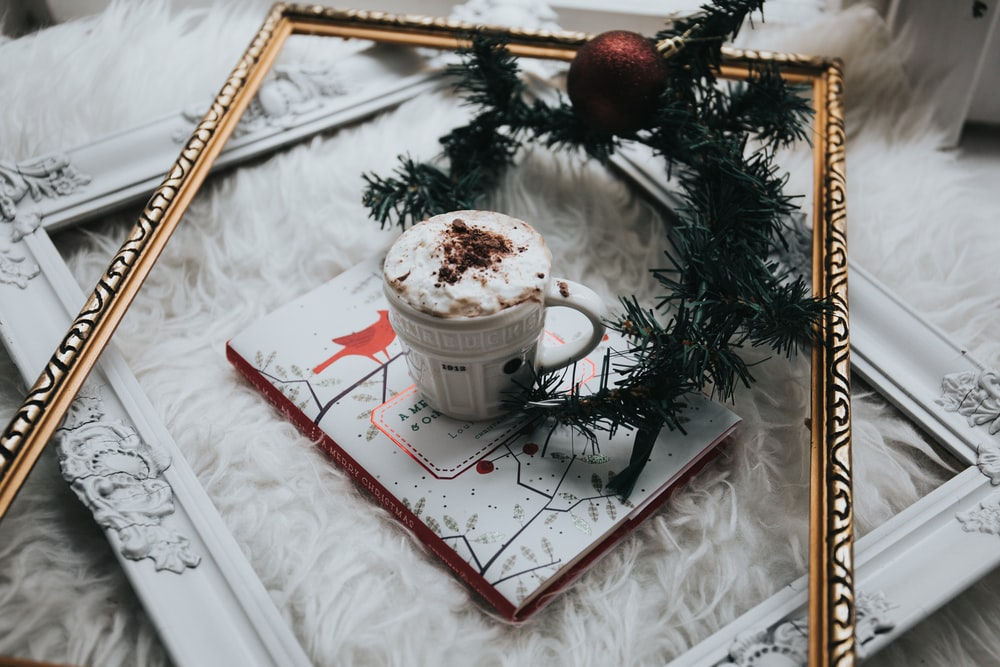 white ceramic mug filled with whit mousse