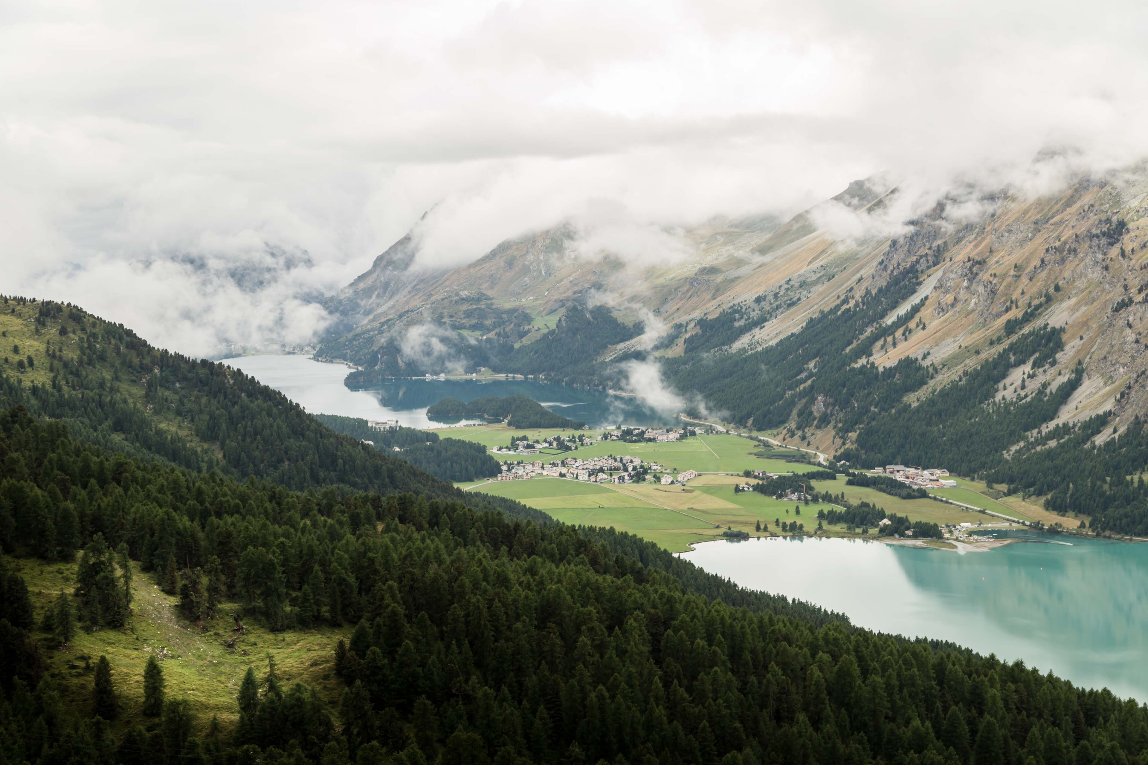 A village between two lakes in a mountain valley