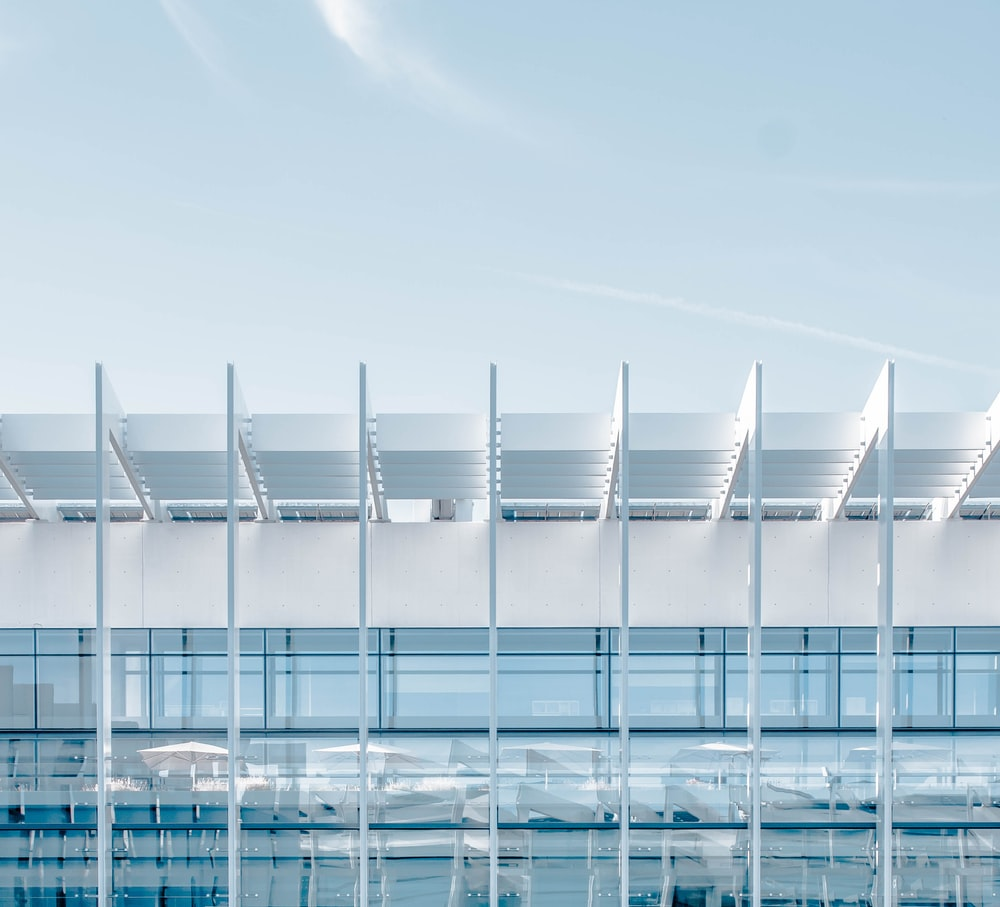 white and clear glass-display building