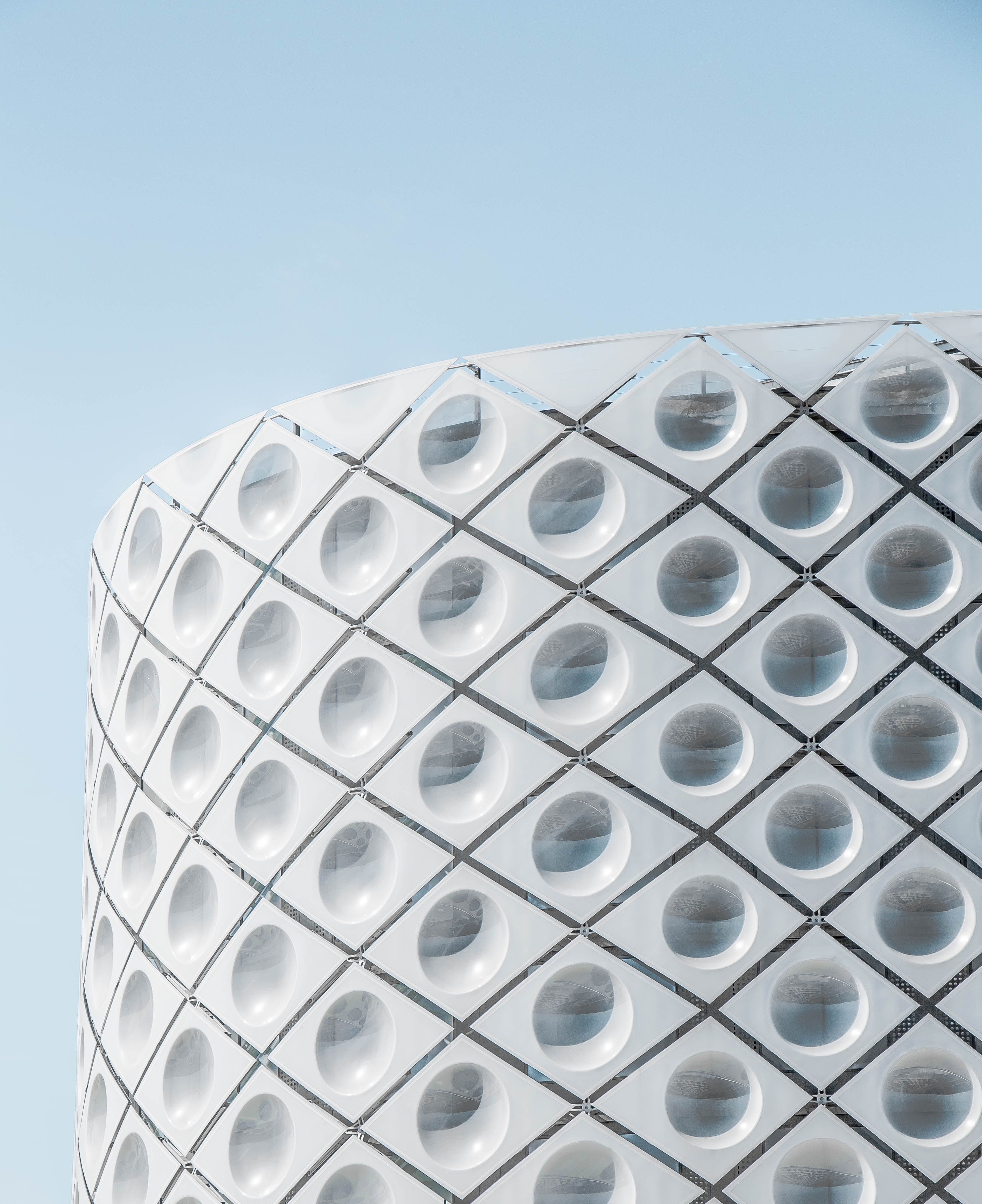 A white round facade with large translucent circles in Madrid