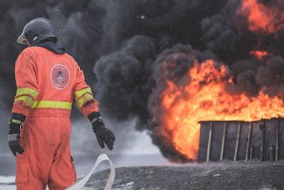 fireman wearing firesuit fire teams background