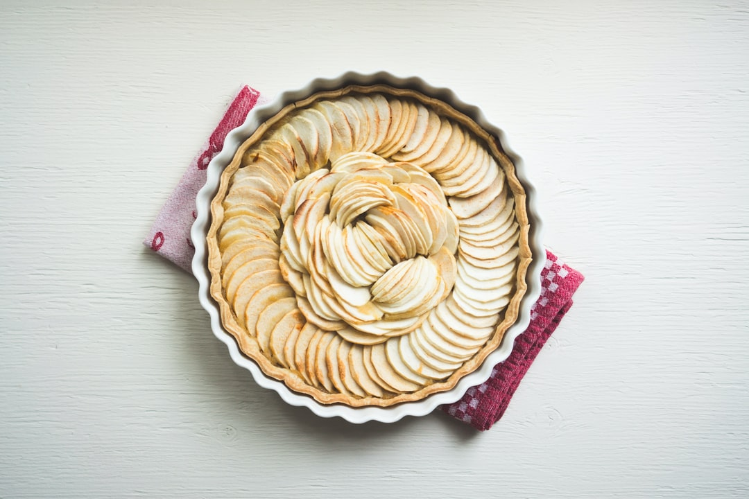 Homemade apple pie topped with fresh slices of fruit
