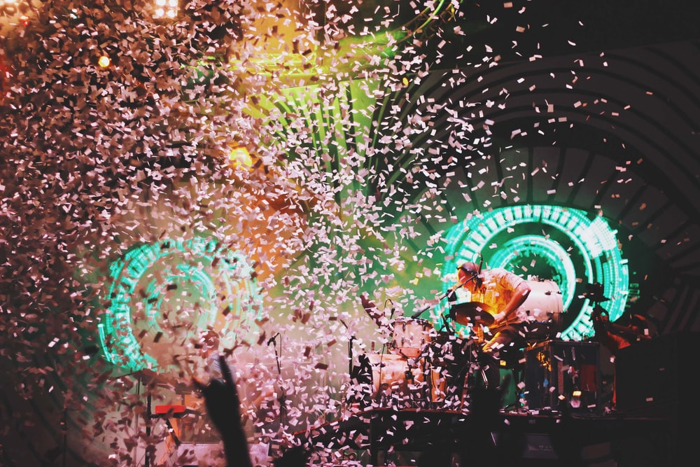 pink confetti dropping on lighted stage