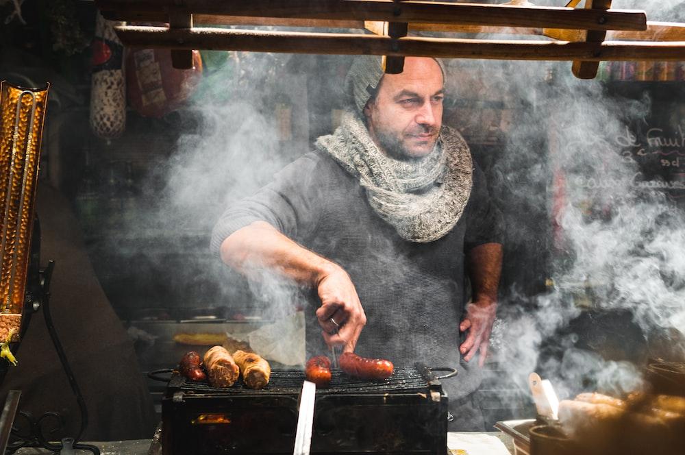 man grilled a hotdog