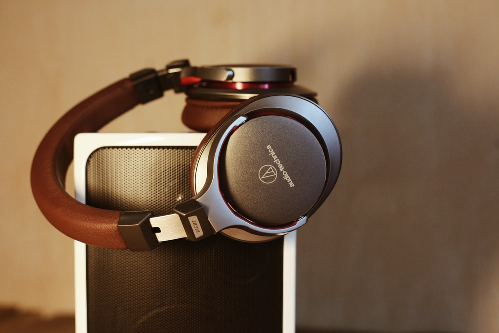 wireless headphones on top of speaker
