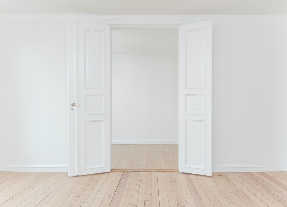 minimalist photography of open door