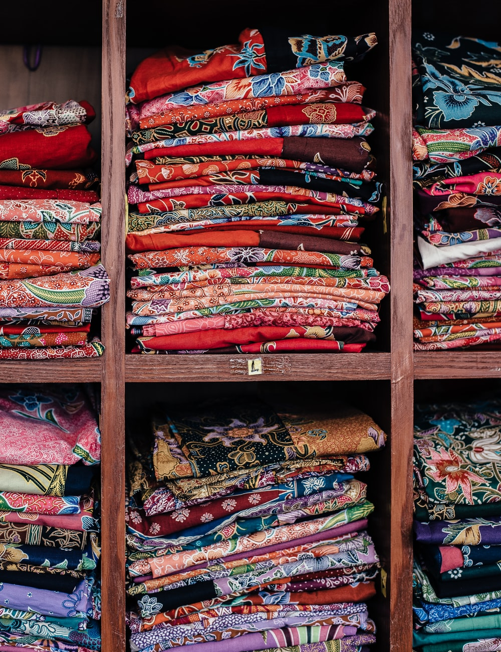 assorted-color cloth on rack
