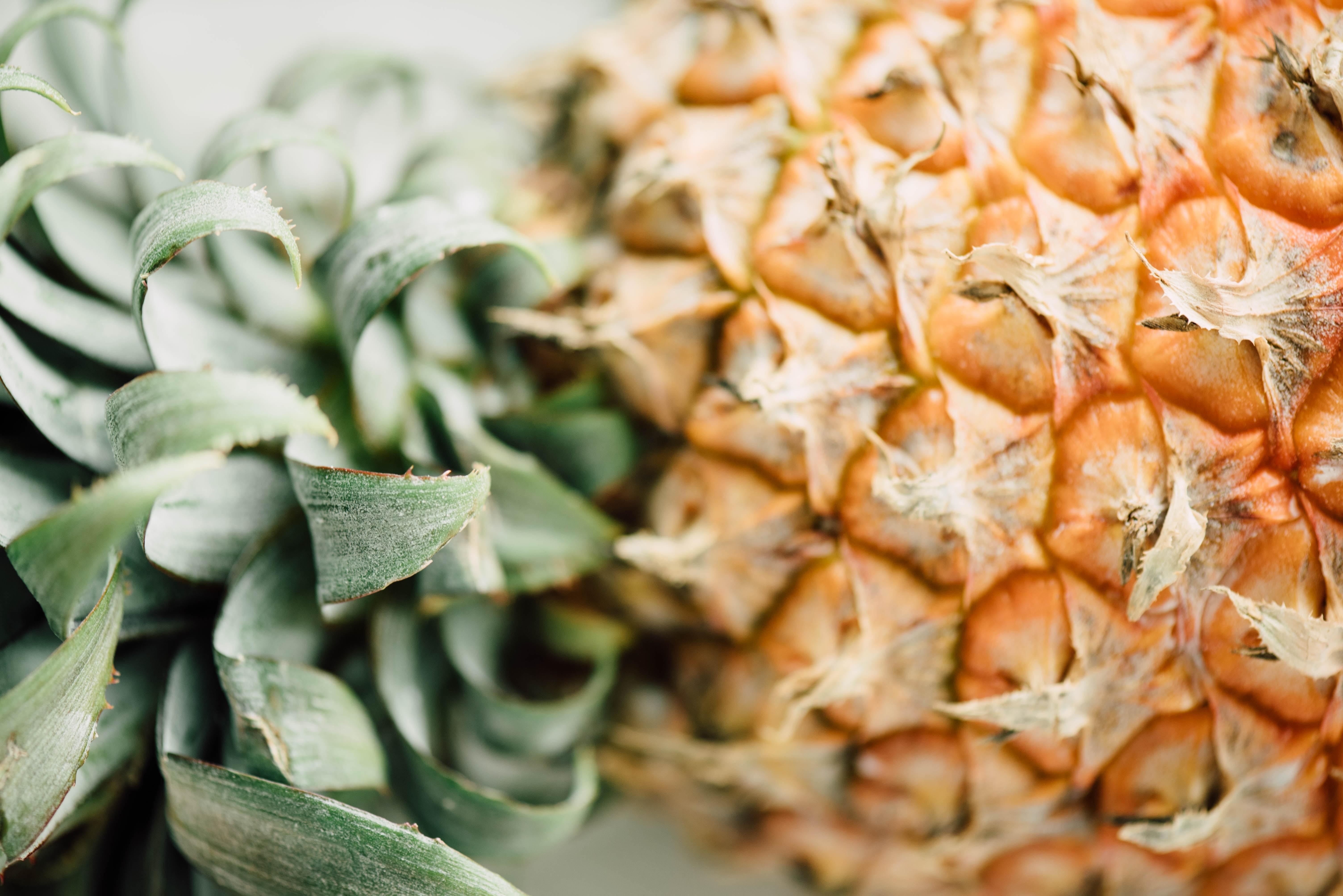 Macro shot of a pineapple lying down.