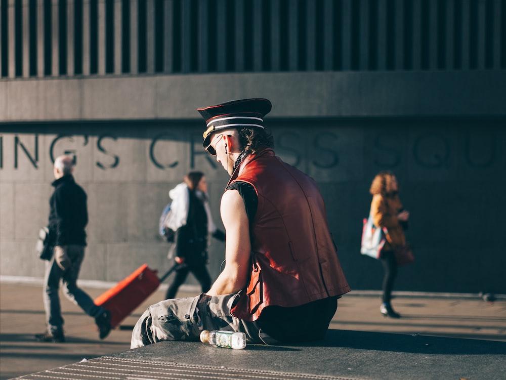 man sitting on pavement