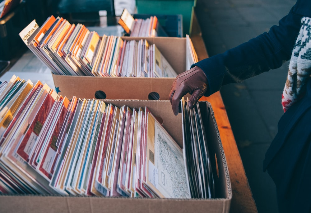 Sifting through record albums in boxes at Southbank Centre