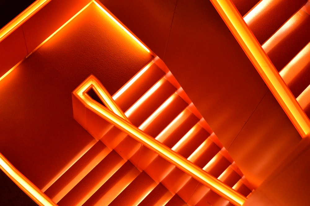 Download background wallpapers unsplash a stairway illuminated by bright orange neons voltagebd Gallery
