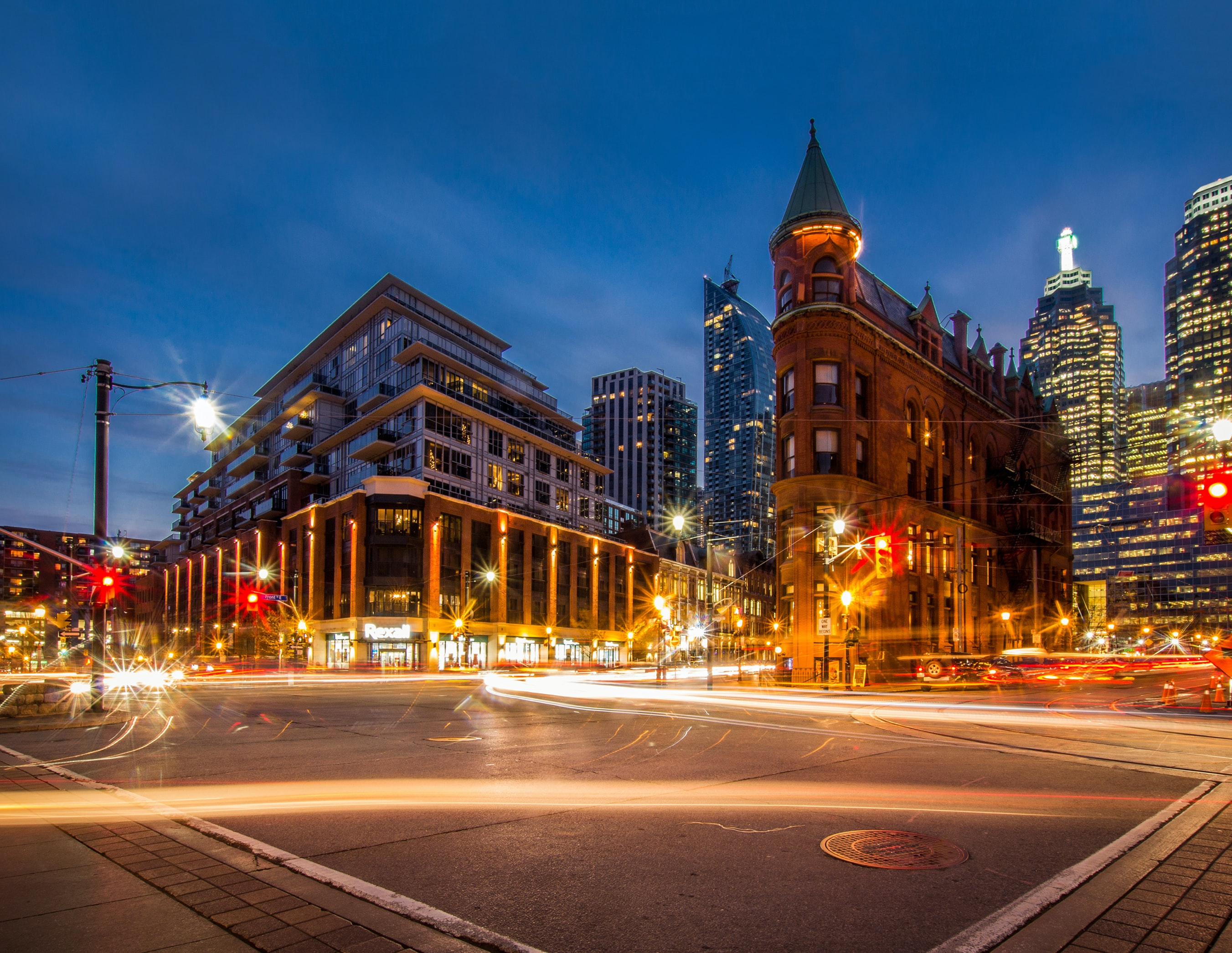 A beautiful background highlighting city lights, with an intersection light trail timelapse