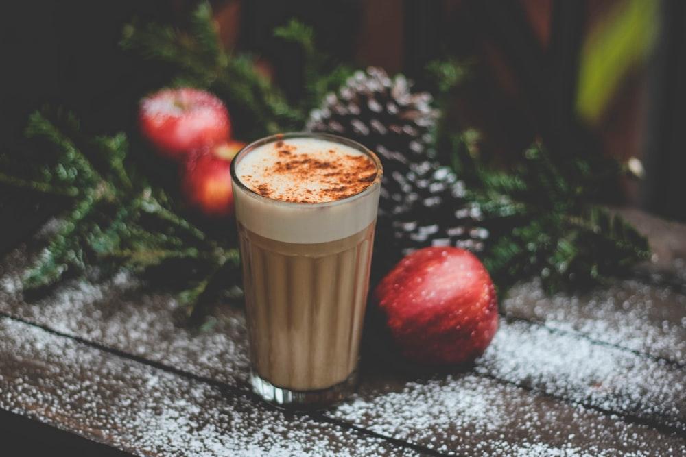 latte field cup beside red apple