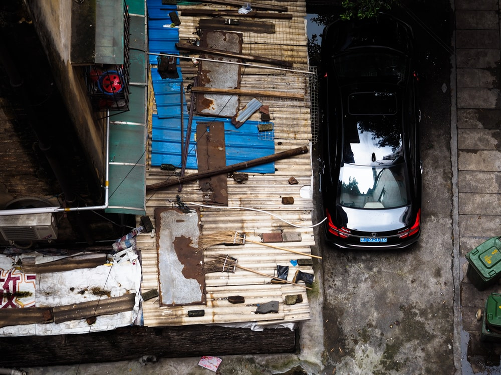 bird's-eye view of black car beside house