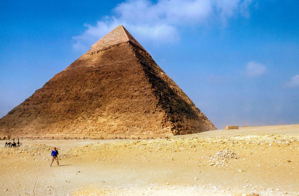 man standing near Pyramid Giza during daytime
