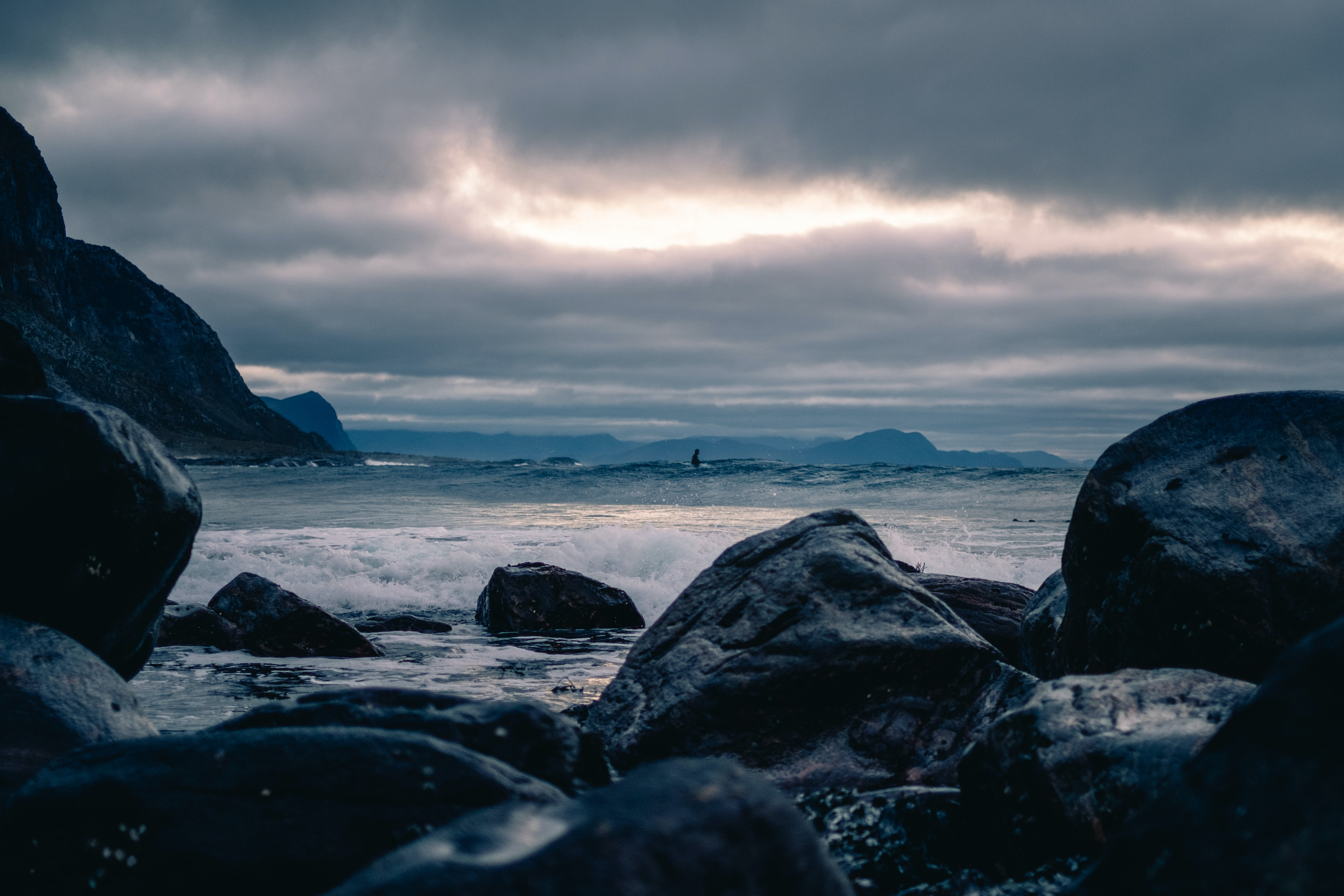 sea waves crashing towards rocks