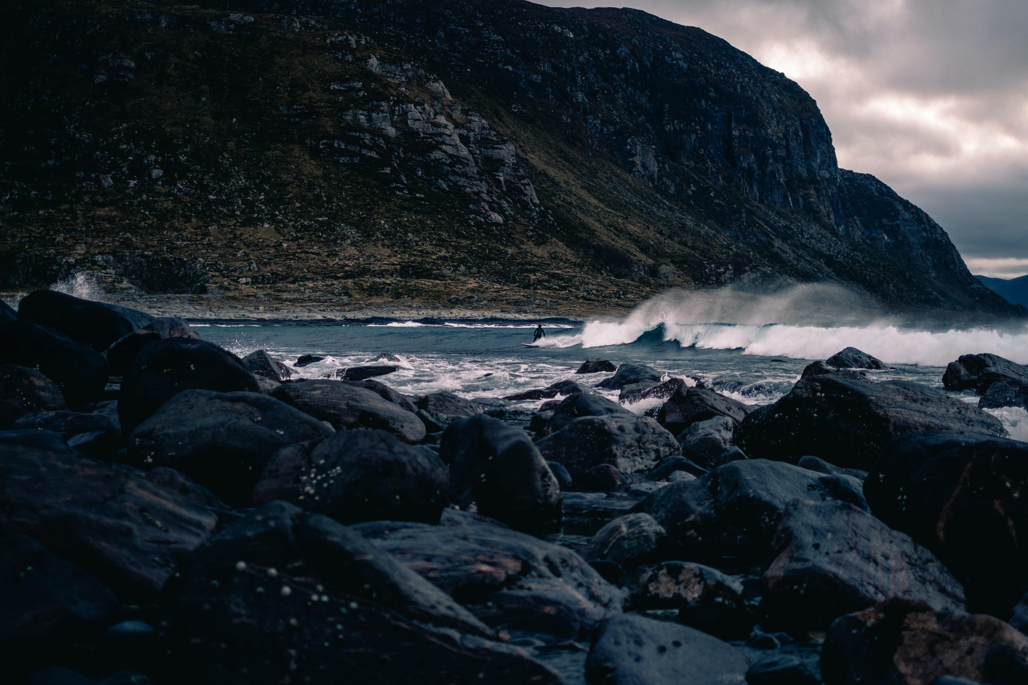 black rocks near sea