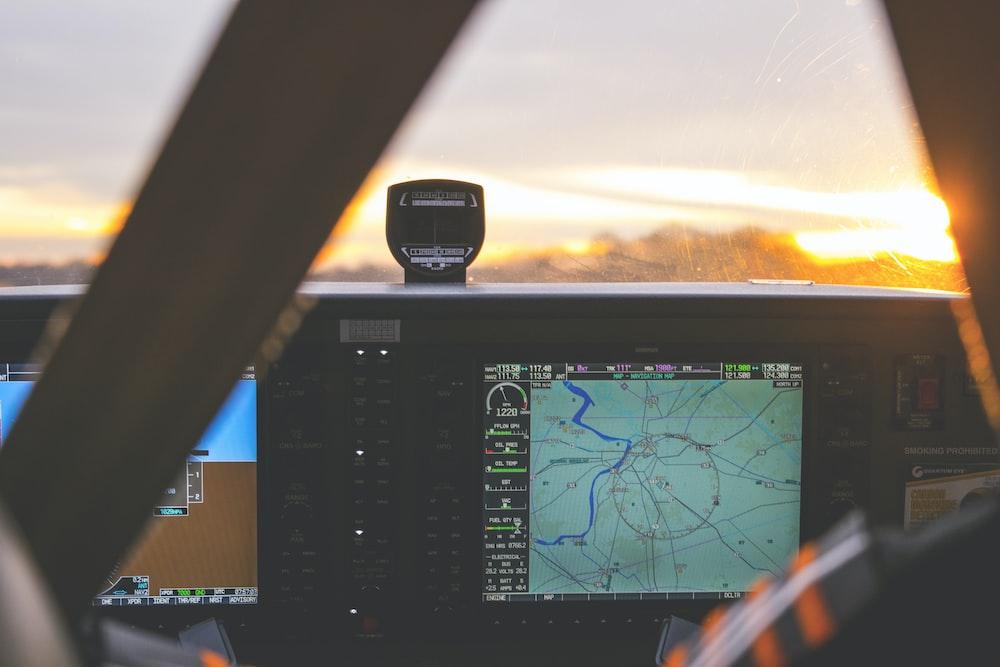 black GPS navigator showing map
