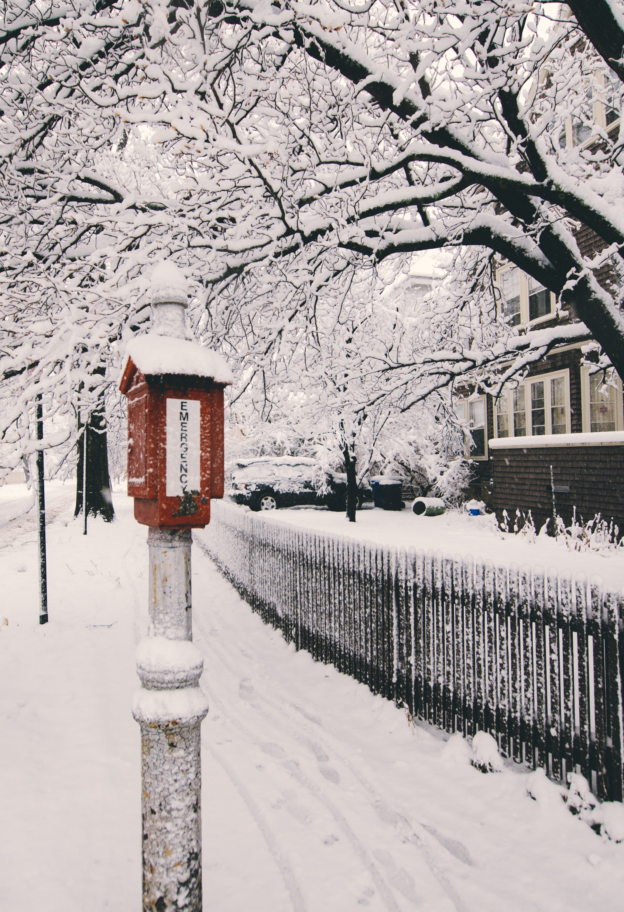 A snow covered residential street.