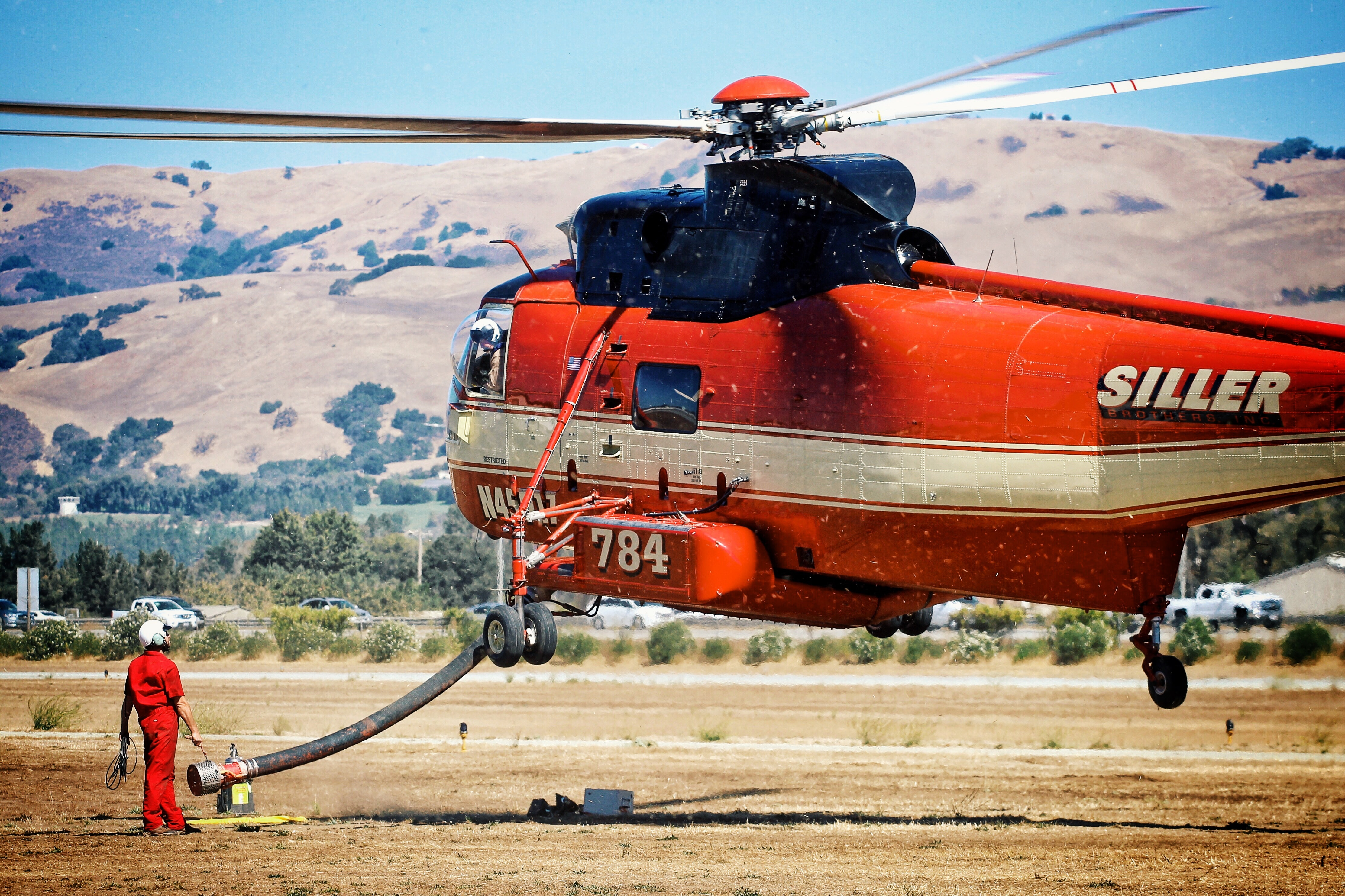 red and white Siller chopper ascending