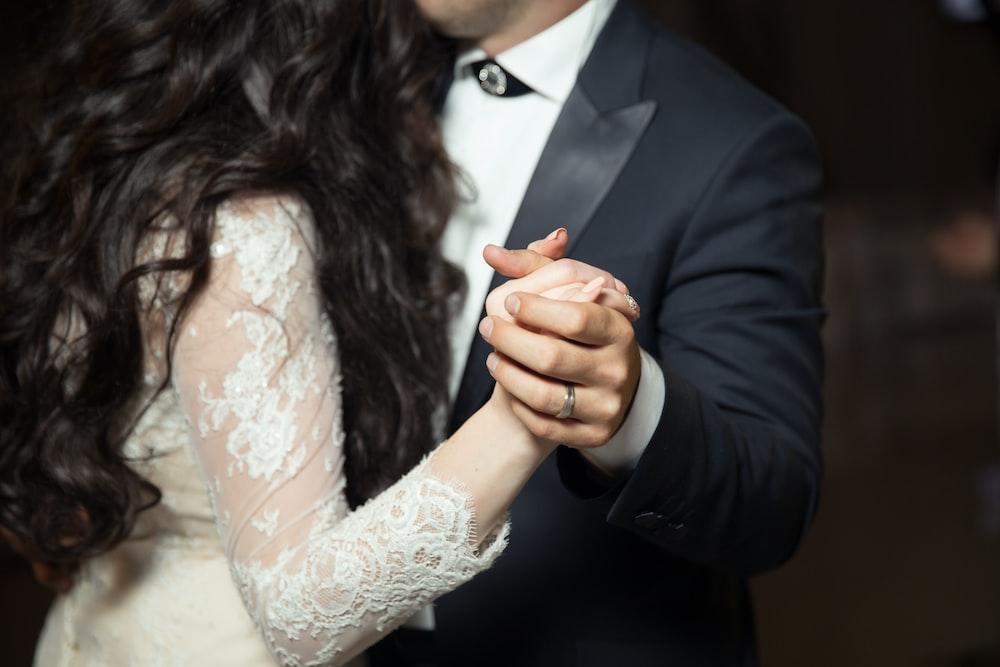 man and woman dancing wearing casual dresses