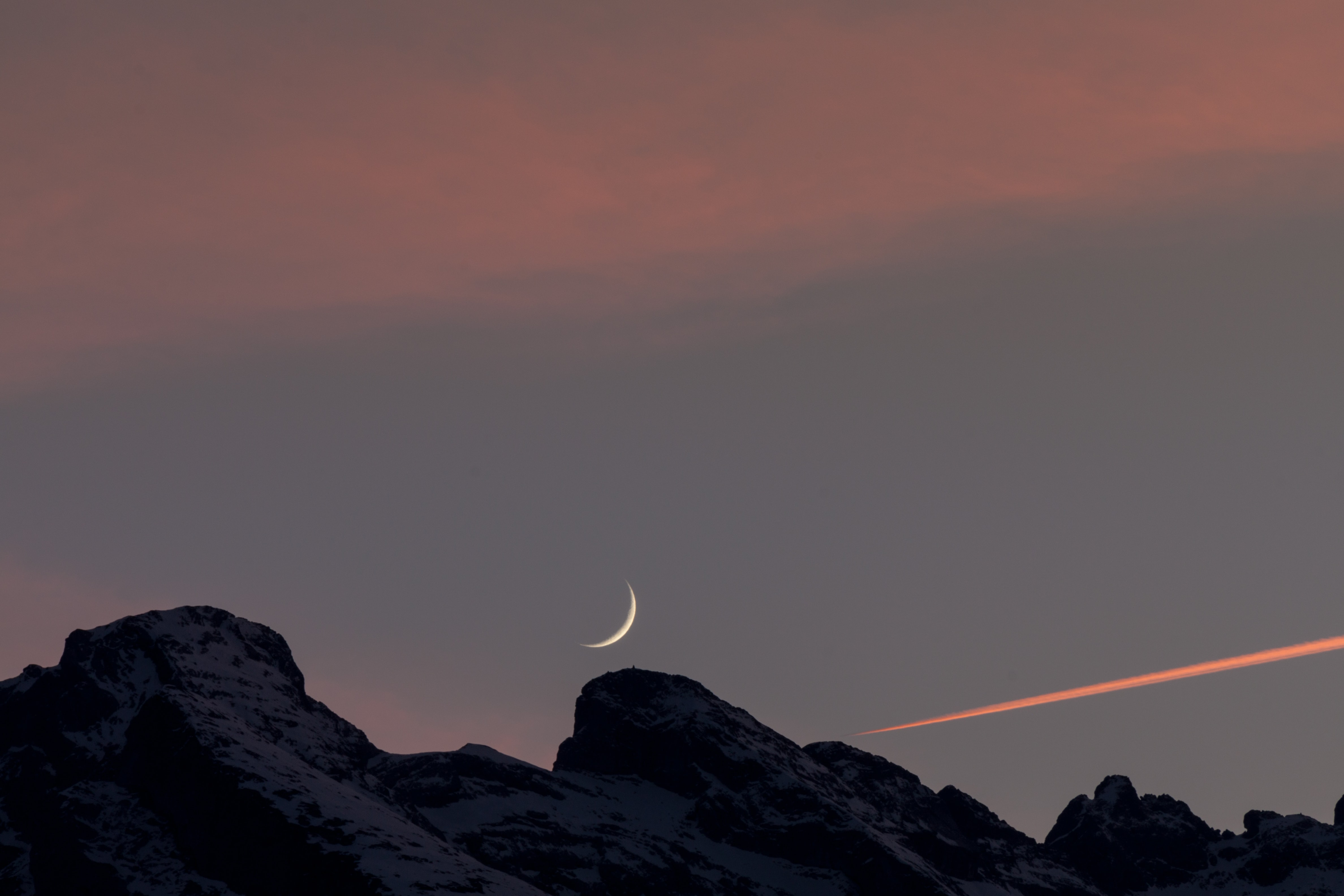 photo of black boulder and crescent moon