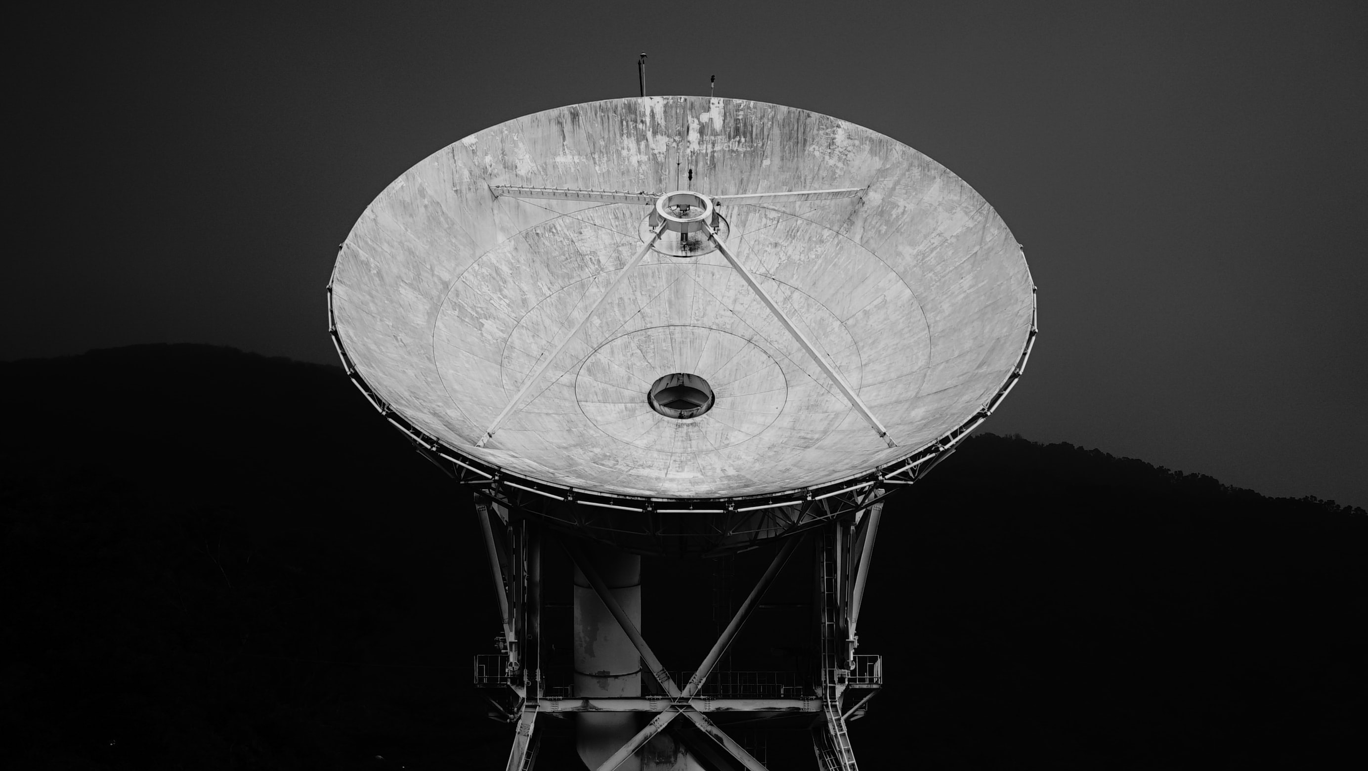 A black-and-white shot of a dish radio telescope
