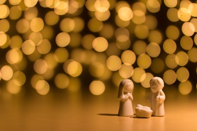 shallow focus photo of the nativity figurine manger zoom background